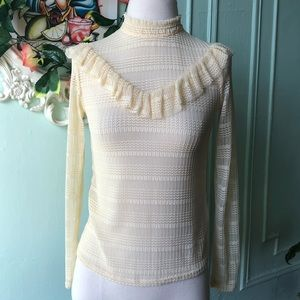 Topshop Cream ruffle blouse.